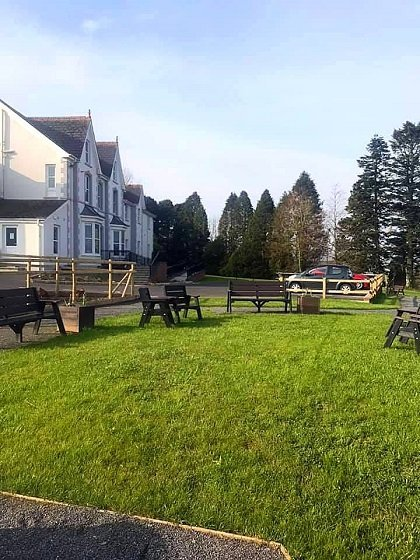 Outdoor seating area on grass, Cartref Croeso Care Home, Pencader, Carmarthenshire