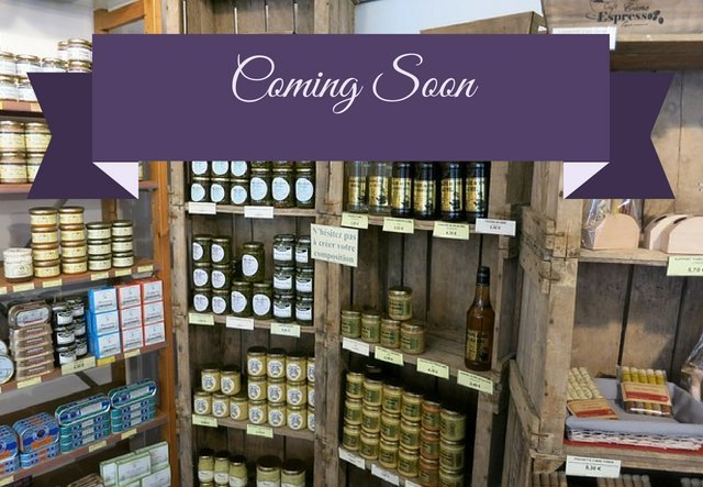 'Coming soon' text with shop shelves in background